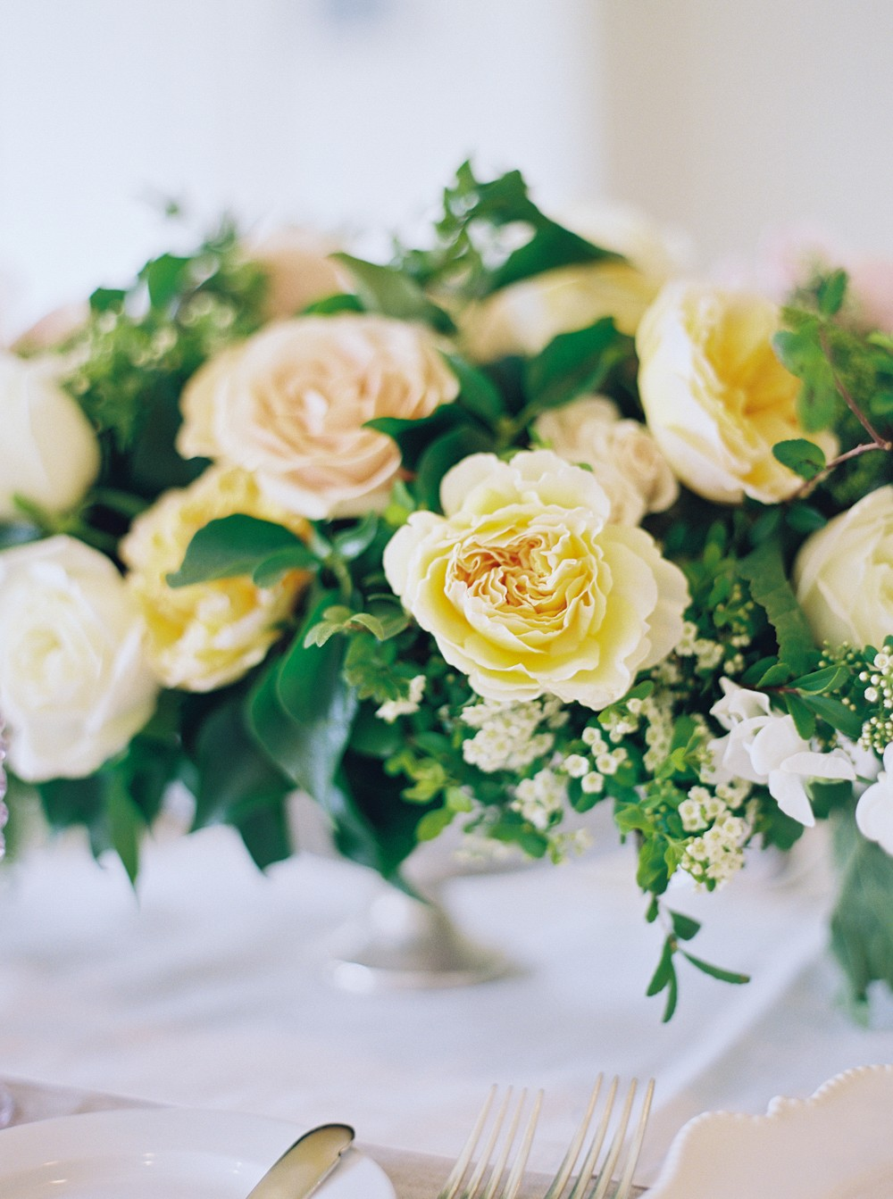 Buttercream colored wedding centerpiece | Sophisticated Real Wedding in Ontario by When He Found Her on Wedding Sparrow