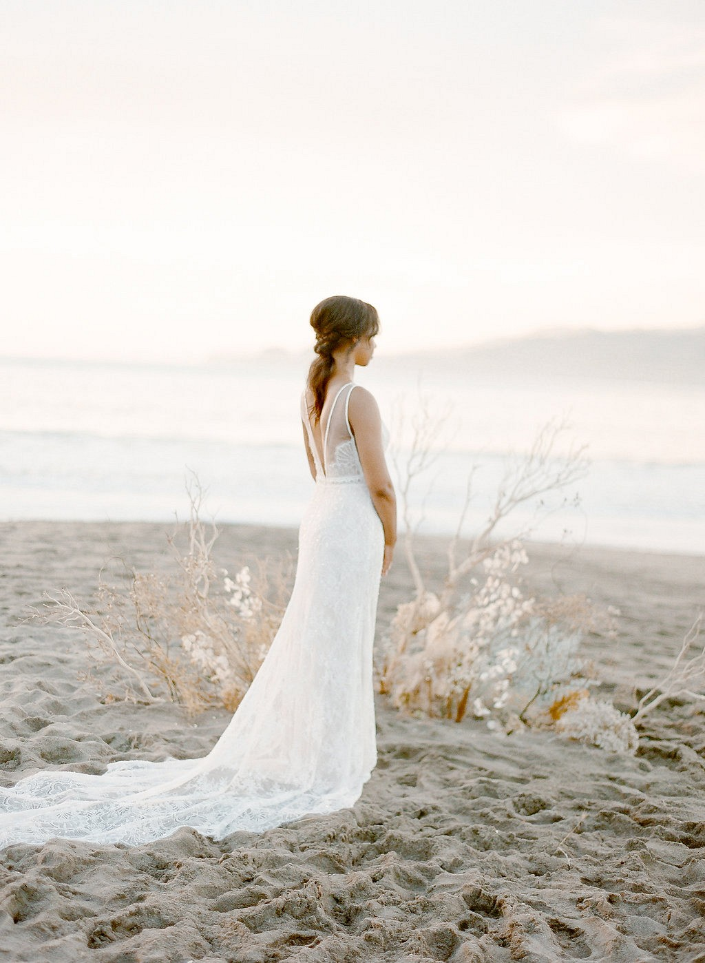 Golden tone element inspired beach wedding