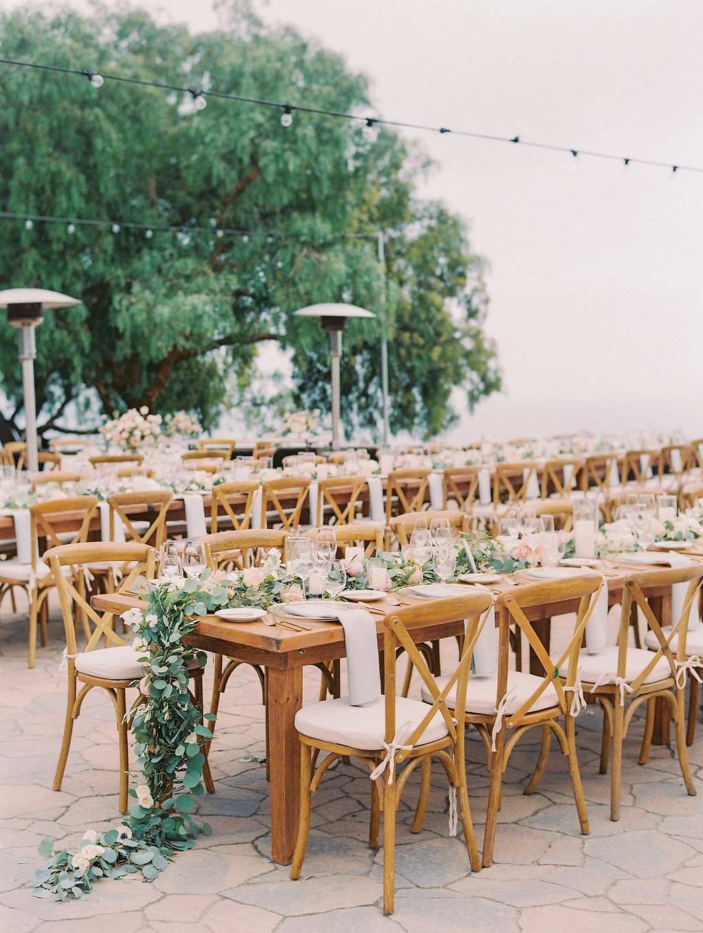 Outdoor wedding with floral arch and blush details