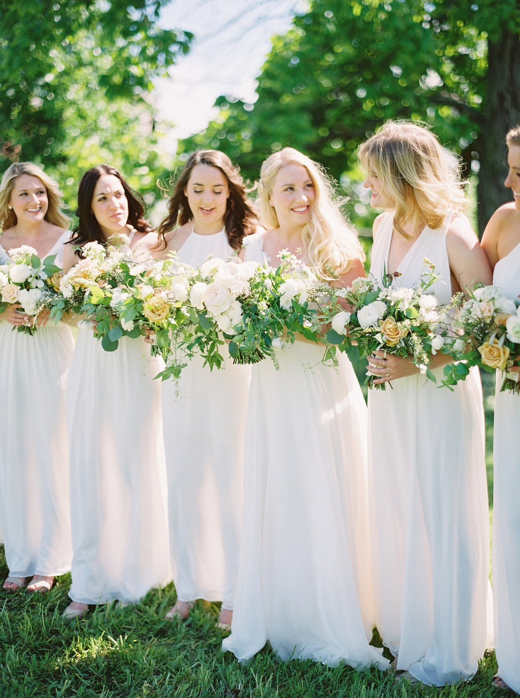 Bridesmaids in white | Heartfelt and Nostalgic Indiana Barn Wedding by Renee Lemaire | Wedding Sparrow fine art wedding blog