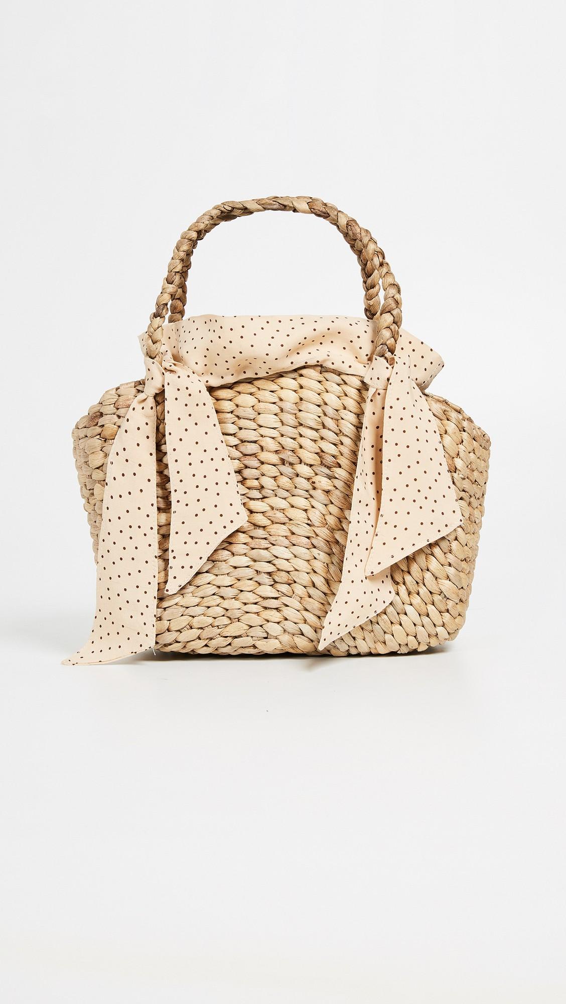 Faithfull the brand straw tote - honeymoon buys - Wedding Sparrow fine art wedding blog