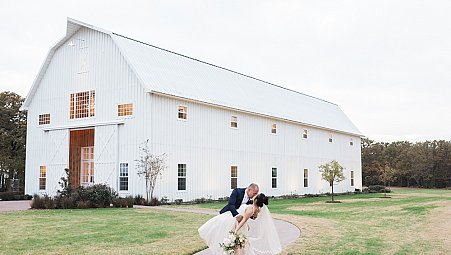 Periwinkle Blue with floral arch at the White Sparrow Barn