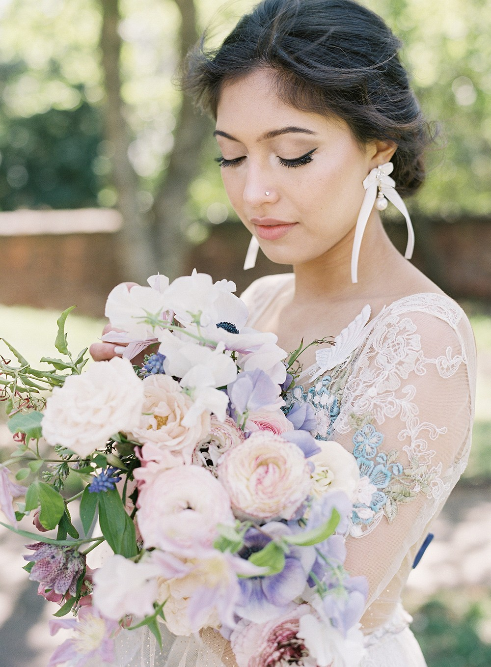 Romantic fairytale editorial with pastel spring blooms
