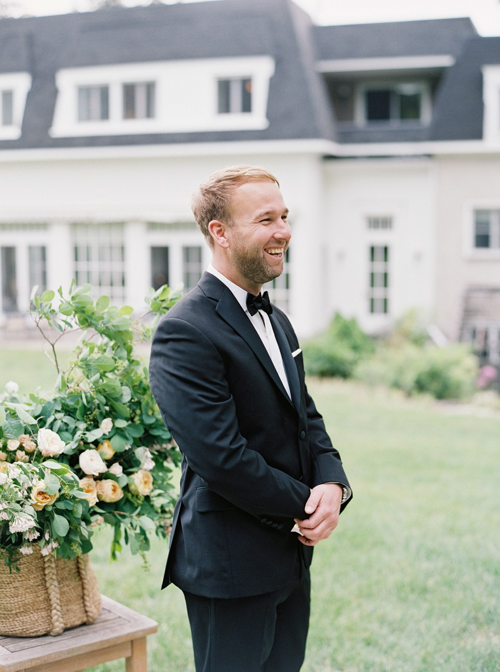 Groom at altar   Sophisticated Real Wedding in Ontario by When He Found Her on Wedding Sparrow