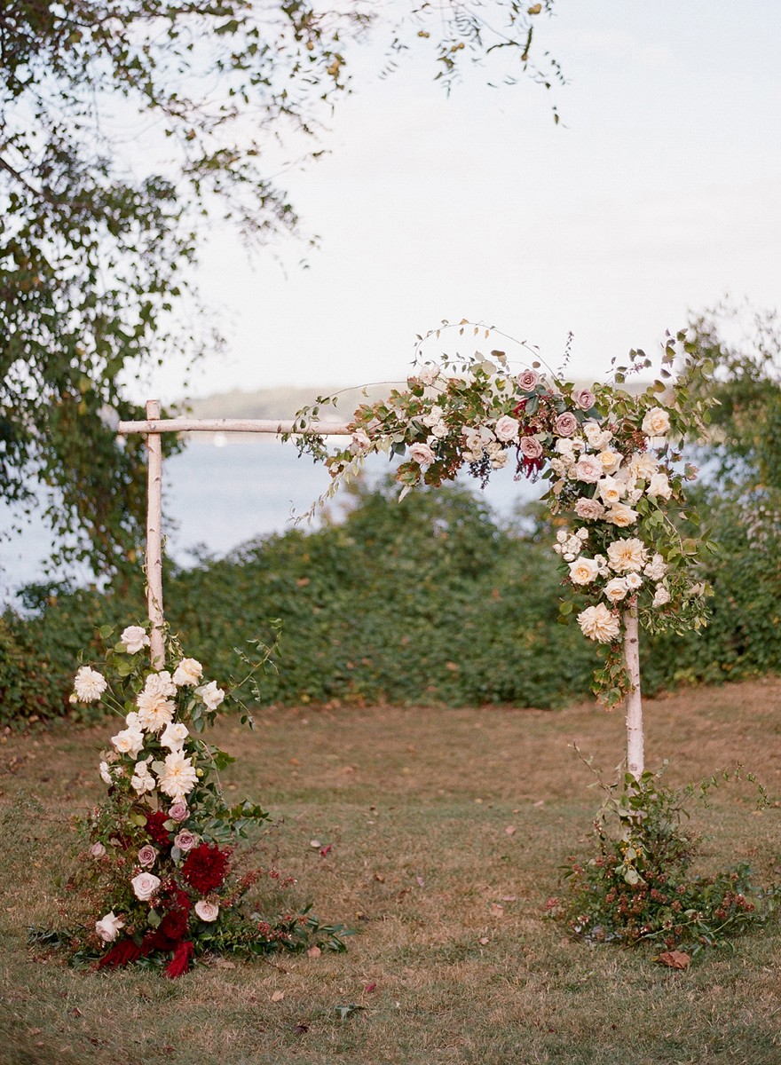 Riverside outdoor wedding with mauve, light purple florals