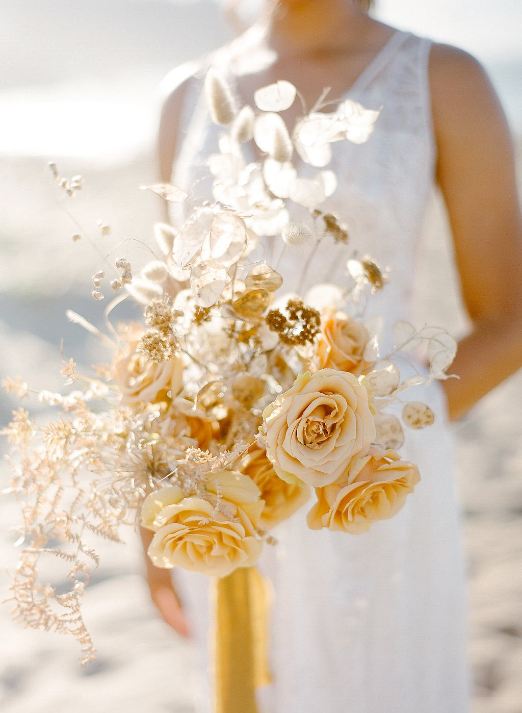 Golden tone element inspired beach wedding