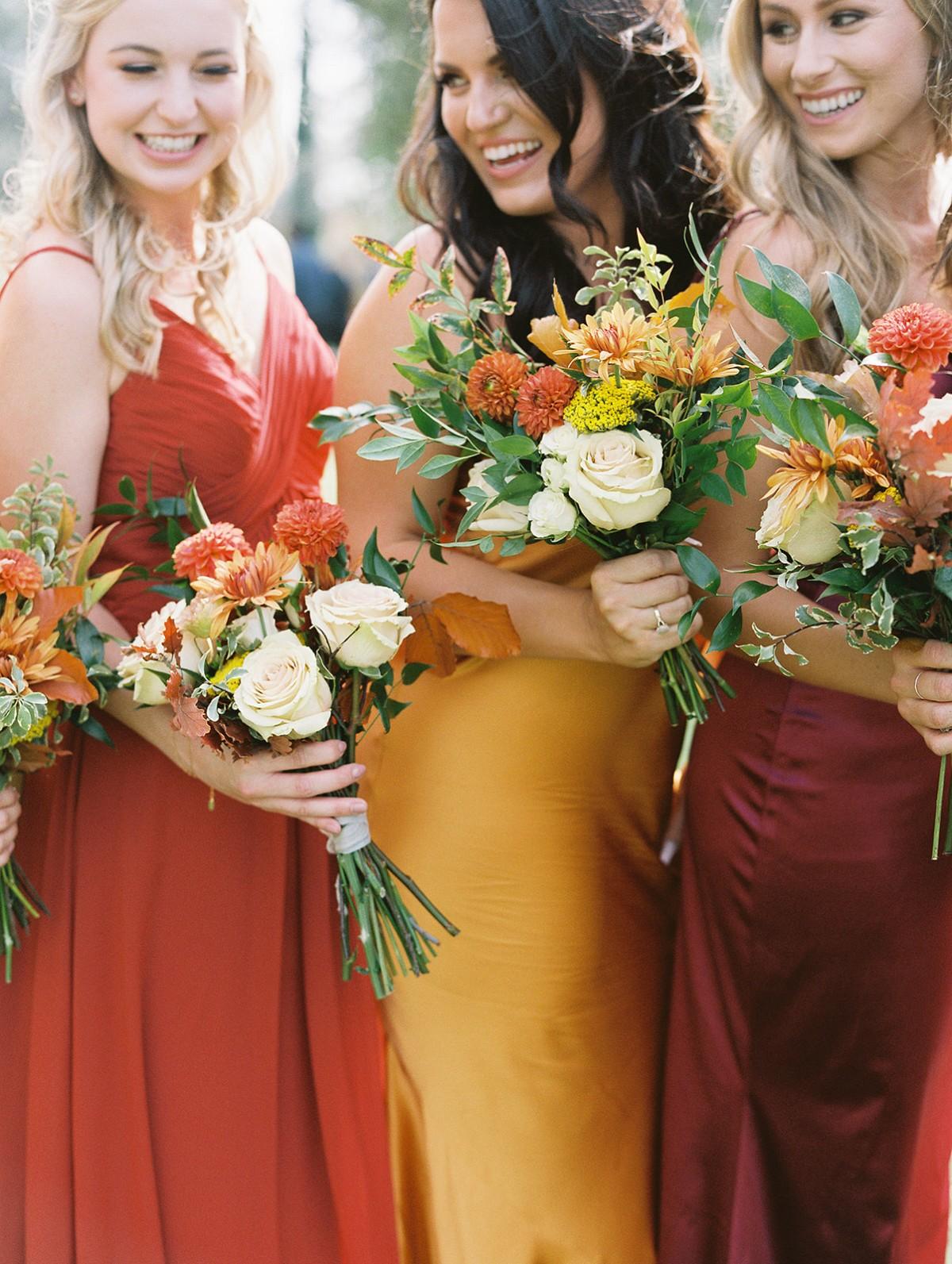 Burnt Orange bridal bouquet with bridesmaids bouquets