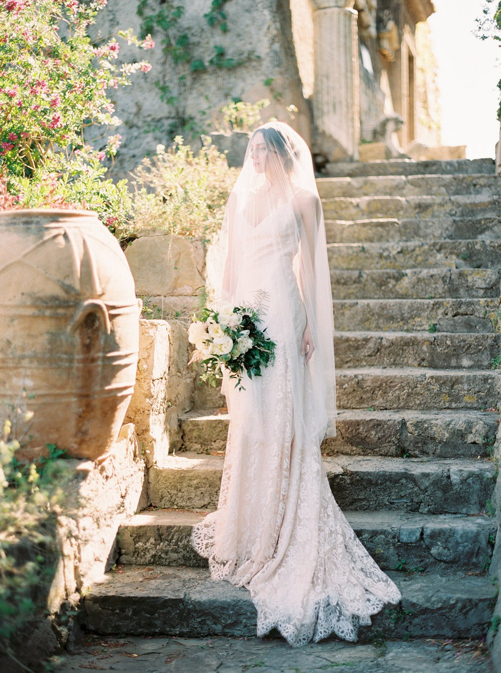 An elegant Amalfi Coast Bridal Session with a backless gown