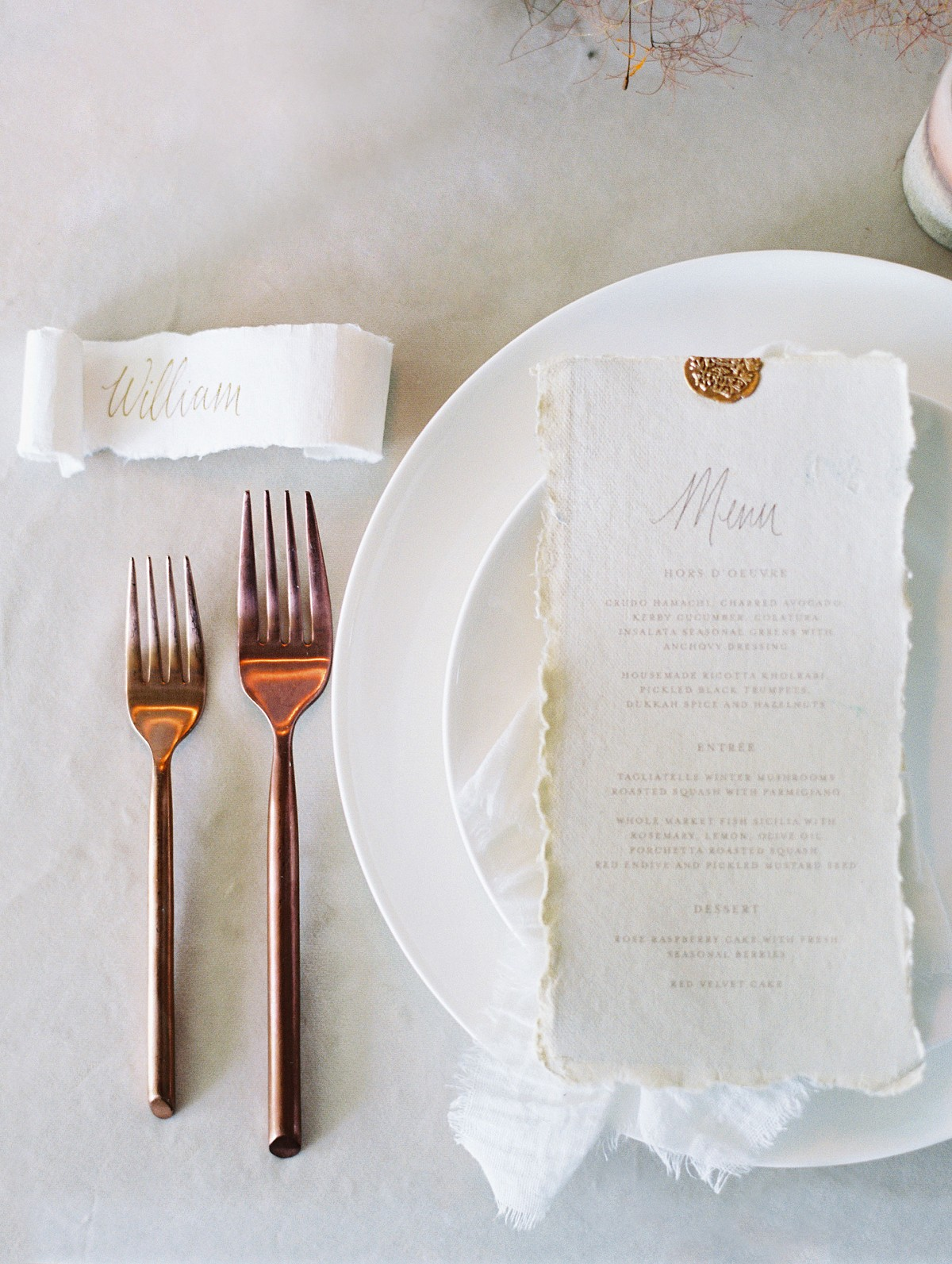 menu with calligraphy and deckled edging