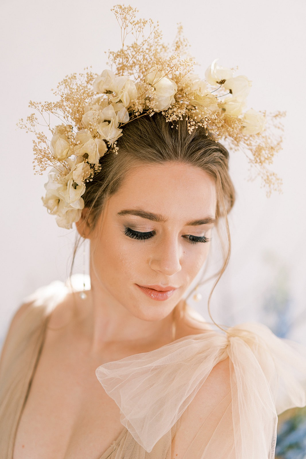 Marina Claire Photography - Bride in off white wedding dress with floral headdress