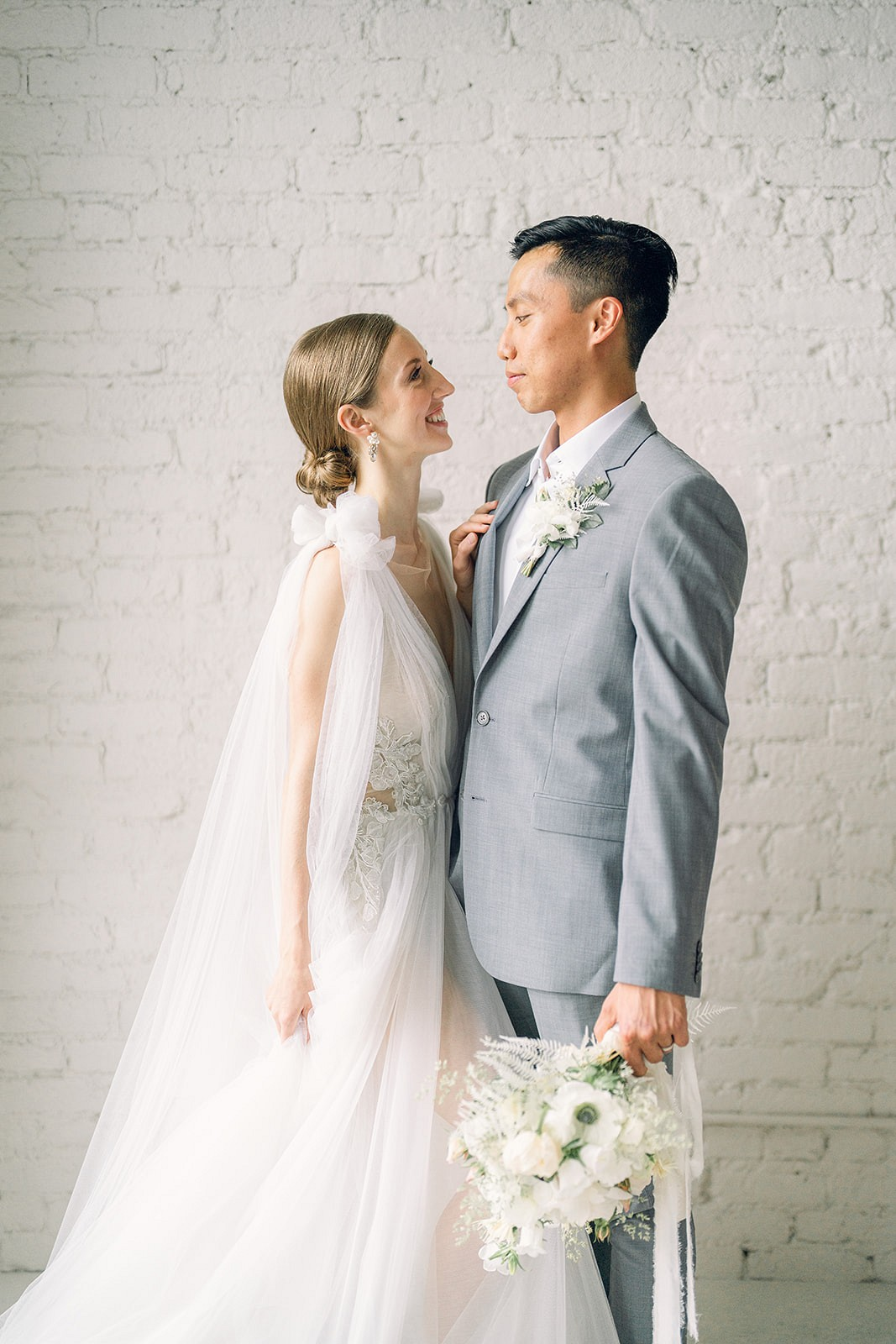 Ballet-inspired bridal editorial with white spring flowers
