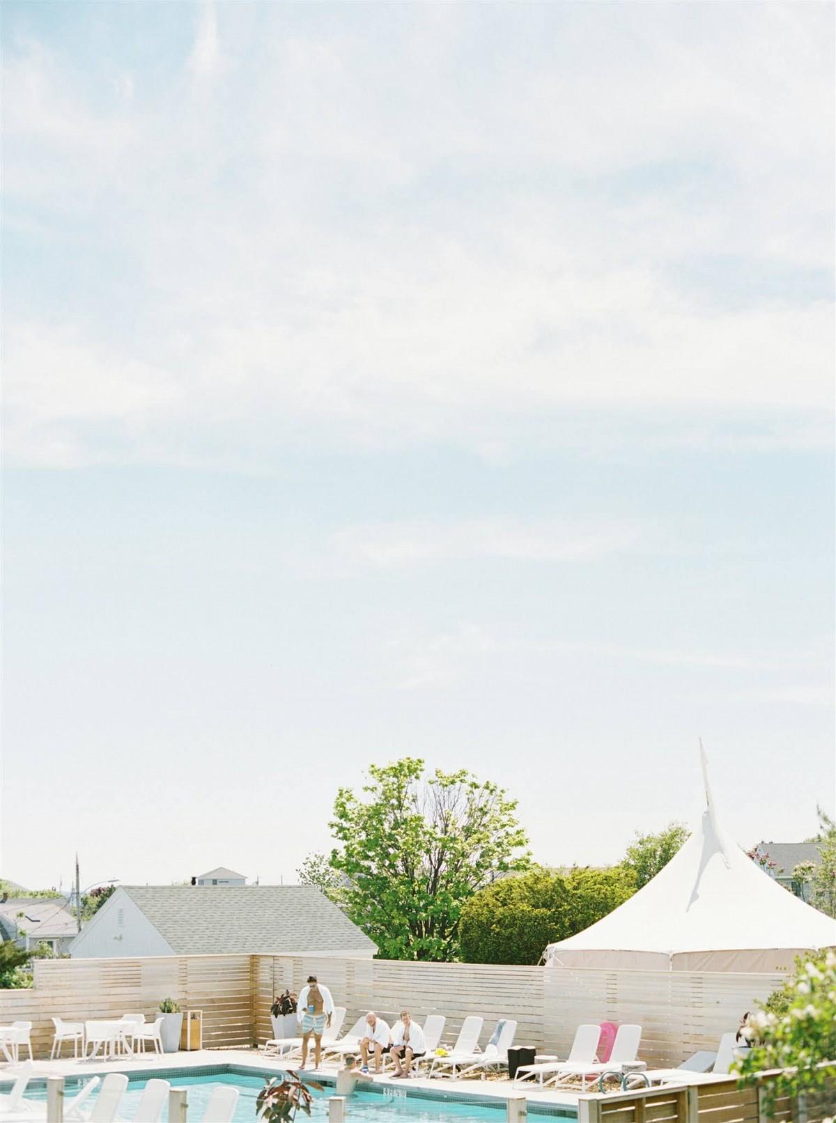 Destination wedding in pool location by Elizabeth Laduca