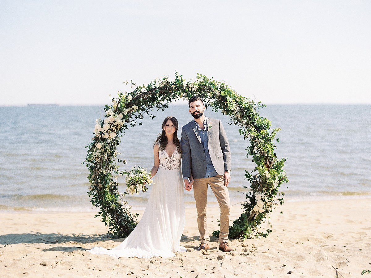 Oceanside Wedding Ceremony with a Floral Arch