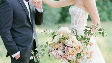 Sheer Corset Wedding Dress Surrounded by Roses in Tennessee